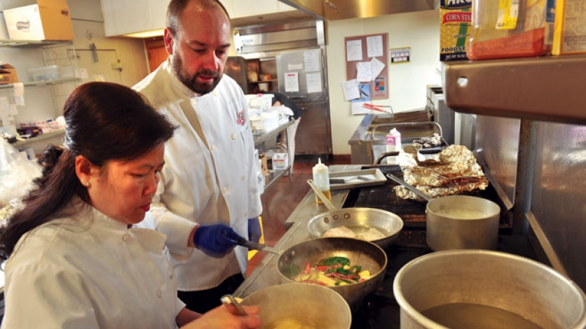 Director of campus dining Richard Phillips and head catering chef Hang Lovan prepare a meal at Central College